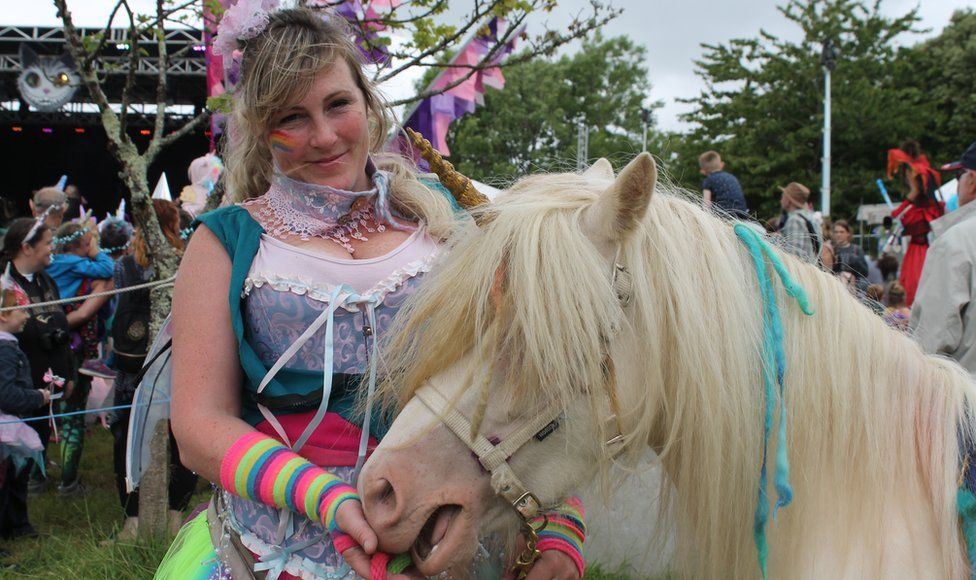 Sarah Sutton with her horse Moon dressed as a unicorn