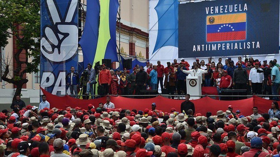 Venezuela's President Nicolas Maduro gestures during a rally at the Miraflores Presidential Palace in Caracas, Venezuela