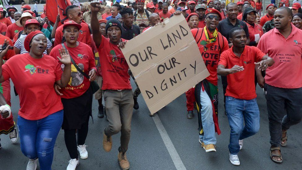 Economic Freedom Fighters (EFF) supporters gather outside the North Gauteng High Court during the partys bid to challenge the constitutionality of the Riotous Assemblies Act on September 20, 2018 in Pretoria, South Africa