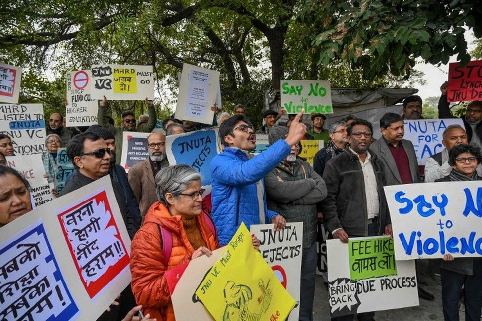 Teachers of Jawaharlal Nehru University (JNU) hold placards as they shout slogans during a protest against an attack on the university students and teachers at the JNU campus in New Delhi on January 6, 2020.