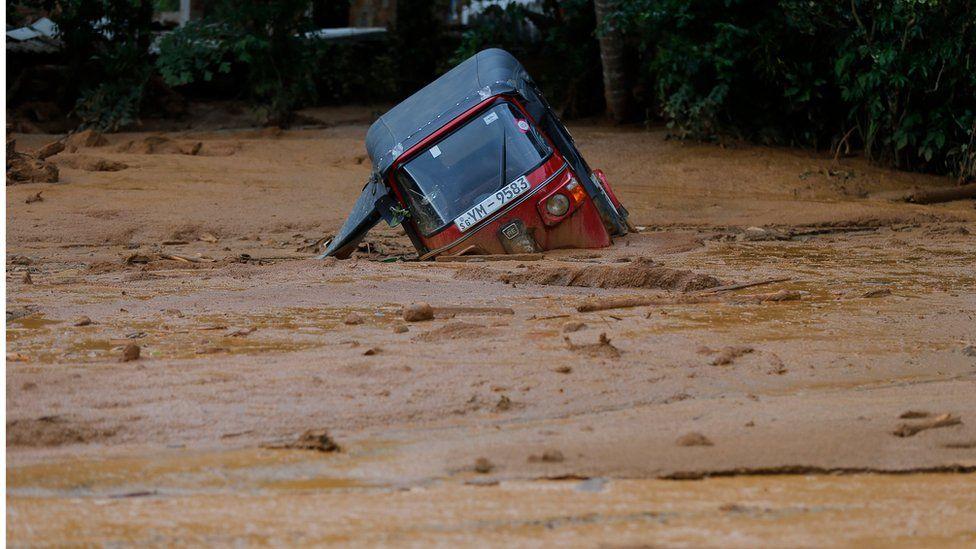 An auto-rickshaw, half submerged in floodwaters in Elangipitiya village on 18 May 2016