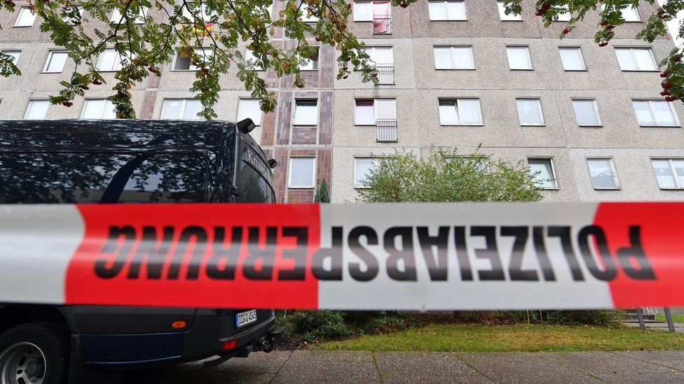 A vehicle of the German Criminal Police is seen behind a police tape cordoning off the area as officers investigate an apartment in the Paunsdorf district of Leipzig, Saxony, Germany, 10 October 2016.