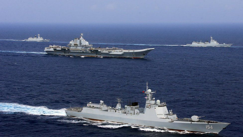 China's aircraft carrier Liaoning (c) takes part in a military drill of Chinese People's Liberation Army Navy in the western Pacific Ocean, April 2018