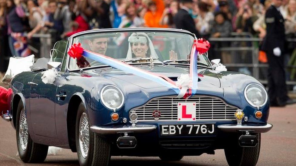 2011: Prince William after his wedding in his father's classic Aston Martin DB6 Volante