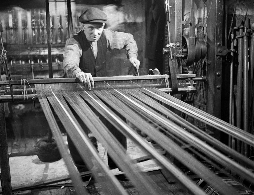 A worker on a loom in 1952