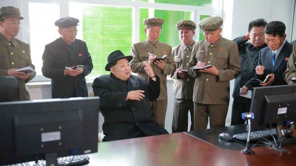 Kim Jong-un speaks to officials at the Paektusan Hero Youth Power Station No. 3 in Ryanggang Province (23 April 2016)