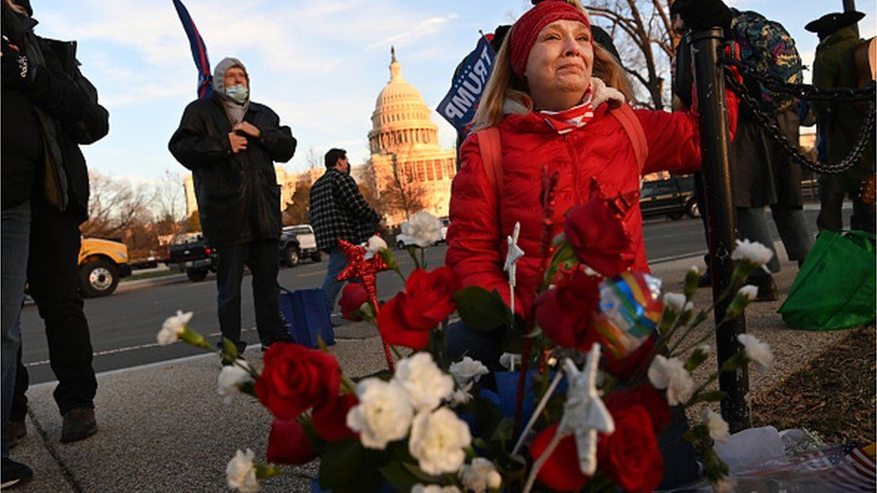A woman cries at a makeshift memorial to Babbitt in Washington, where she died