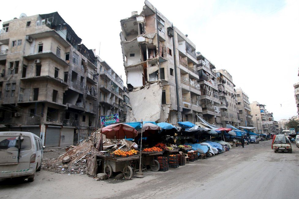 Damaged buildings in the rebel-held al-Shaar district of Aleppo, Syria (10 February 2016)