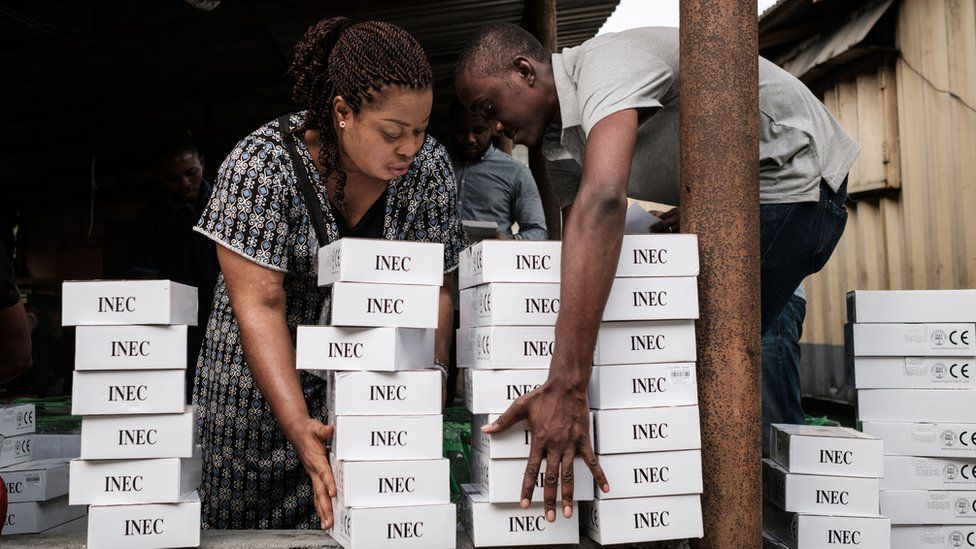 Nigerian electoral officials with card-reading machines