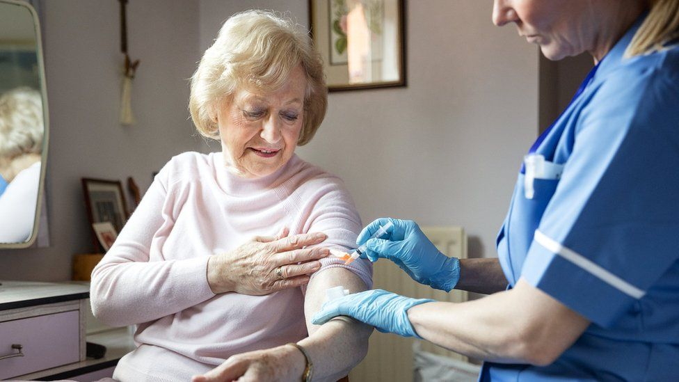 Woman receiving a flu jab
