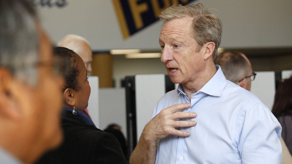 Democratic presidential candidate Tom Steyer talks to voters inside the Nevada Caucus at Cheyenne High School in North Las Vegas, Nevada, February 22, 2020.