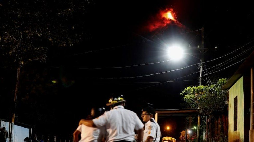 Several firefighters help the residents to evacuate the little village of El Rodeo, due to the eruption of Volcan de Fuego (Volcano of Fire), in the town of Escuintla, Guatemala, 19 November 2018.