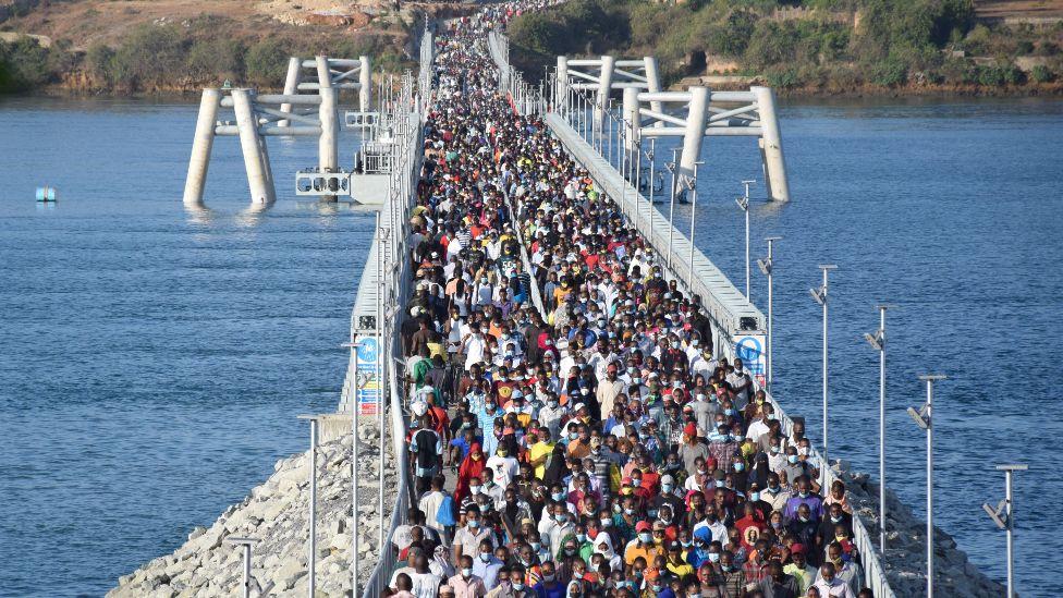 Commuters walk across the floating bridge in Mombasa, Kenya - Wednesday 31 March 2021
