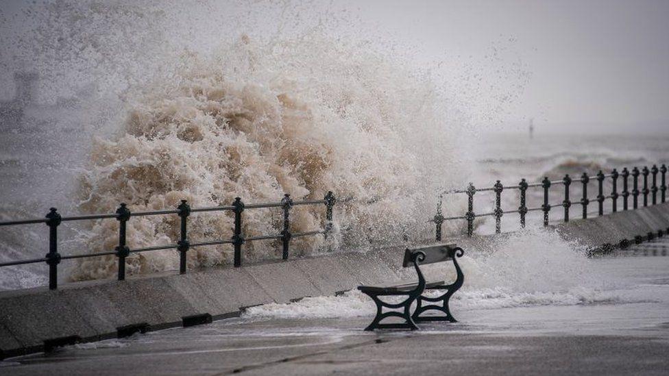 Waves crashing into the coast of New Brighton