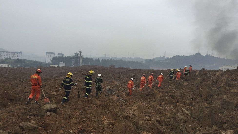 Rescuers search for survivors at the site of a landslide at an industrial park in Shenzhen, Guangdong province, China, December 20, 2015.