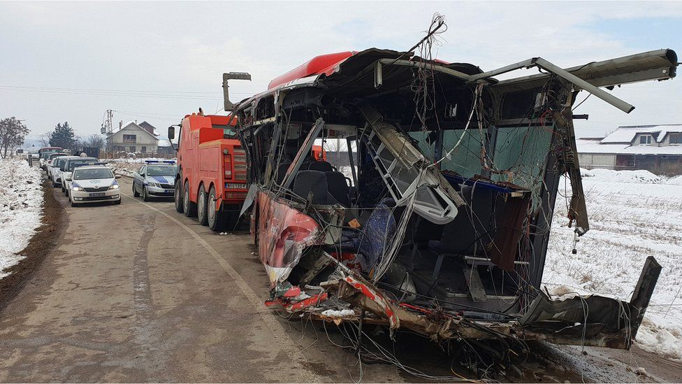 The wreckage of a vehicle at the scene of a crash between a bus and a train at a railway crossing in the village of Donje Medjurovo