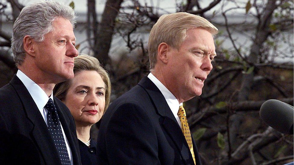 US President Bill Clinton (L) and First Lady Hillary (C) listen as US House Minority Leader Dick Gephardt (R) addresses the nation 19 December at the White House after the US House of Representatives impeached Clinton on charges of perjury and obstruction of justice