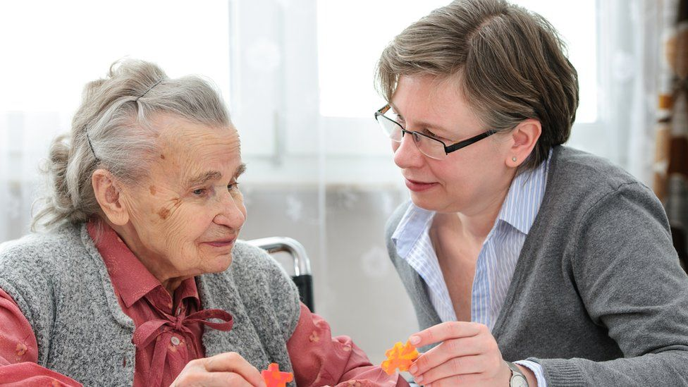 An elderly lady with her care nurse