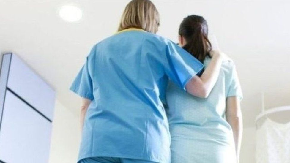 Woman with nurse