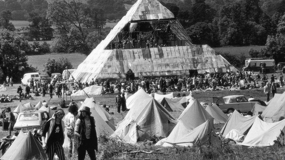 June 1971: Hippies at the second Glastonbury Festival, which saw the first use of a pyramid stage.