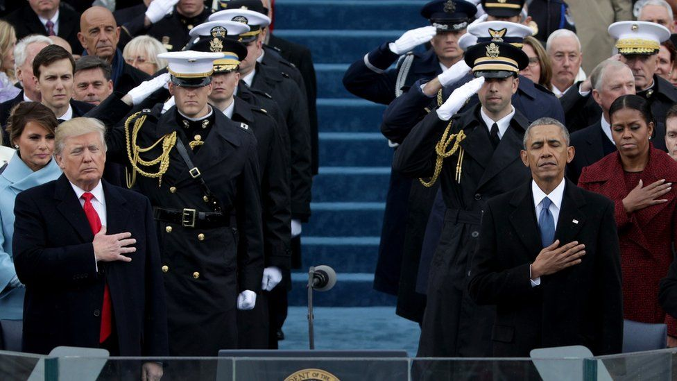 President Donald Trump and former president Barack Obama place their hands on their hearts during the national anthem on the West Front of the U.S. Capitol on January 20, 2017 in Washington, DC.