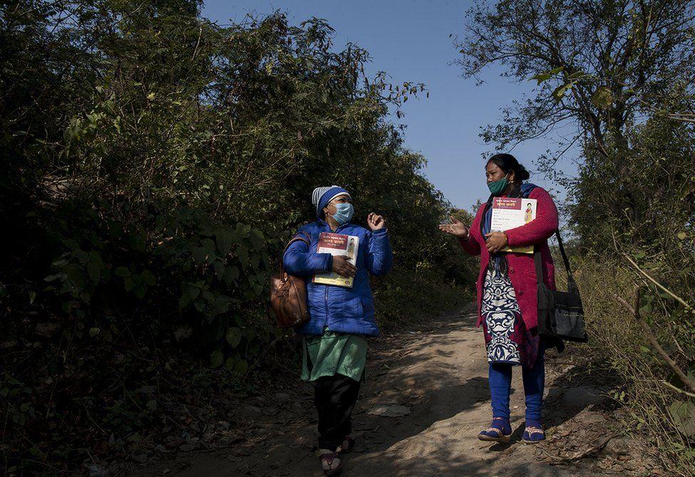 Health activists Seema Pal and Rama Negi