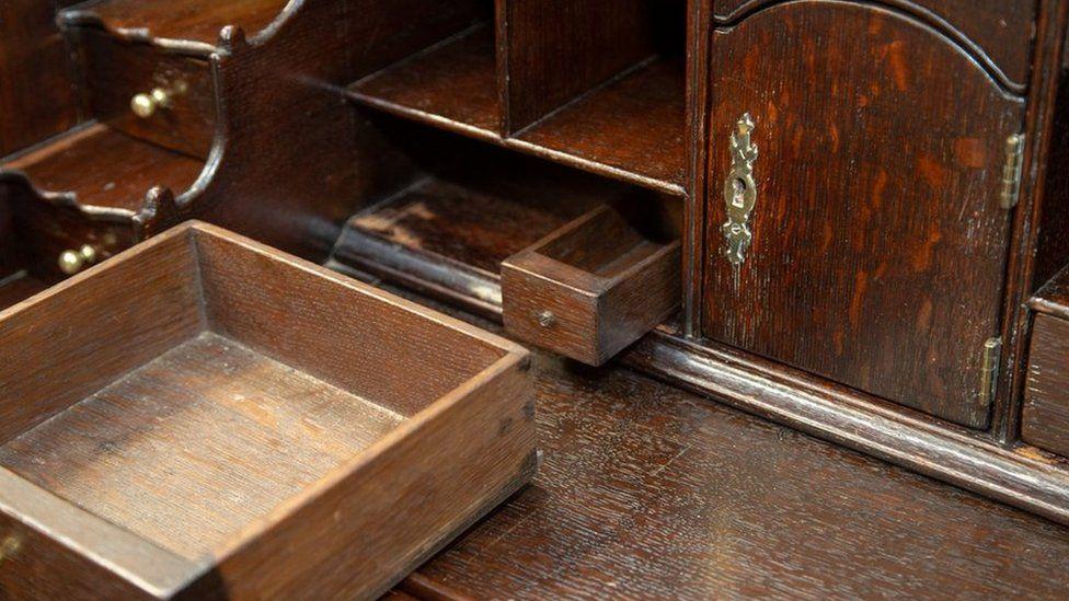 The hidden drawer in the bureau