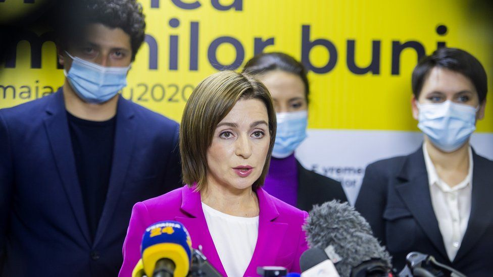 Presidential candidate Maia Sandu (C) speaks to media after polling stations closed in the second round of presidential elections in Chisinau, Moldova, 15 November 2020