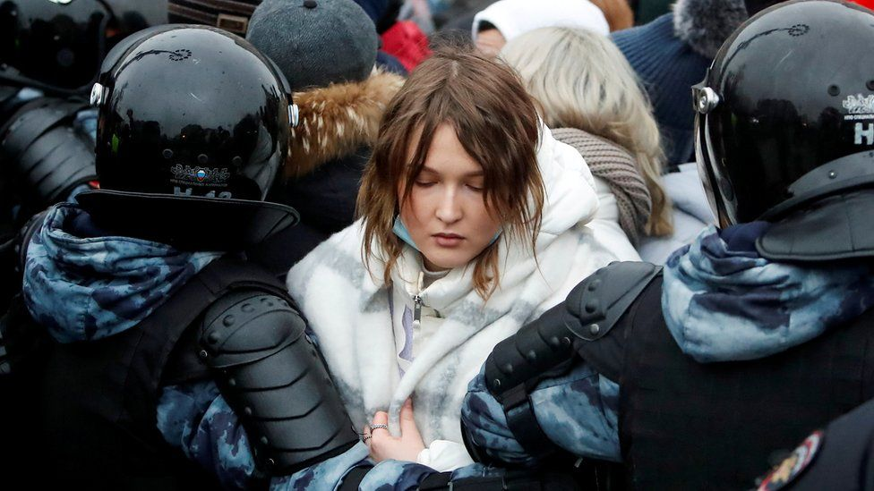 Law enforcement officers detain a woman during a rally in support of jailed Russian opposition leader Alexei Navalny in Moscow, Russia January 23, 2021