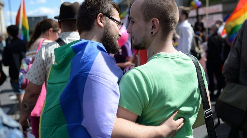 Participants embrace during the annual Gay Pride Parade in Warsaw, Poland, 11 June 2016.