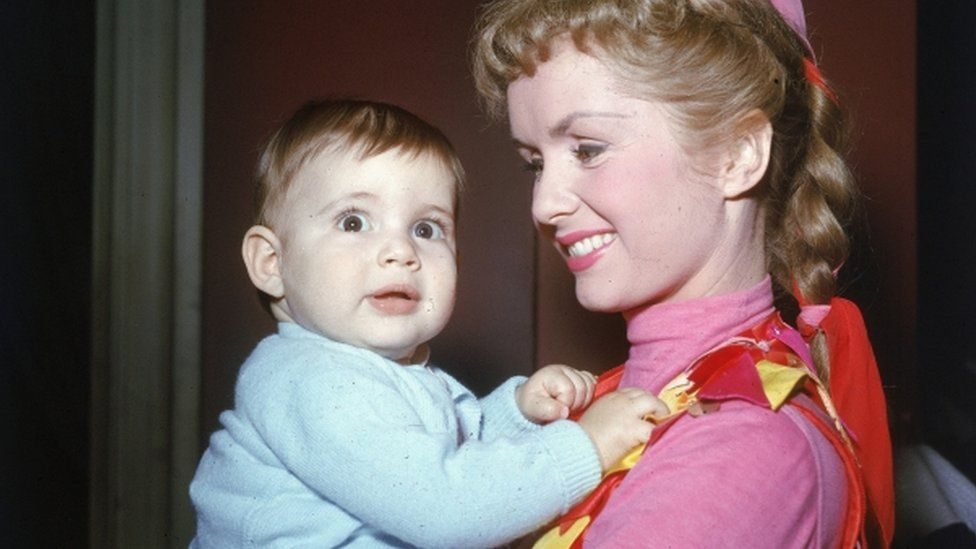 Carrie Fisher as a baby with actress mother Debbie Reynolds