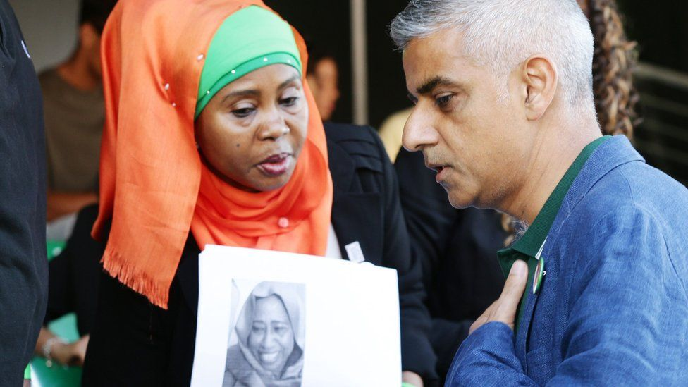 Family member of a victim of Grennfell Tower fire with London Mayor Sadiq Khan