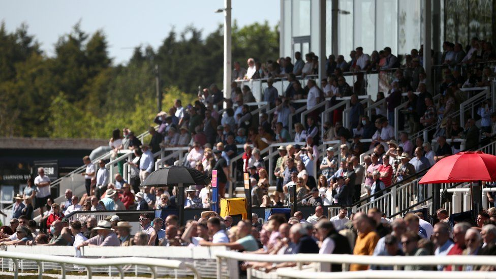 Racegoers enjoy the sunny weather at Uttoxeter Racecourse on Sunday