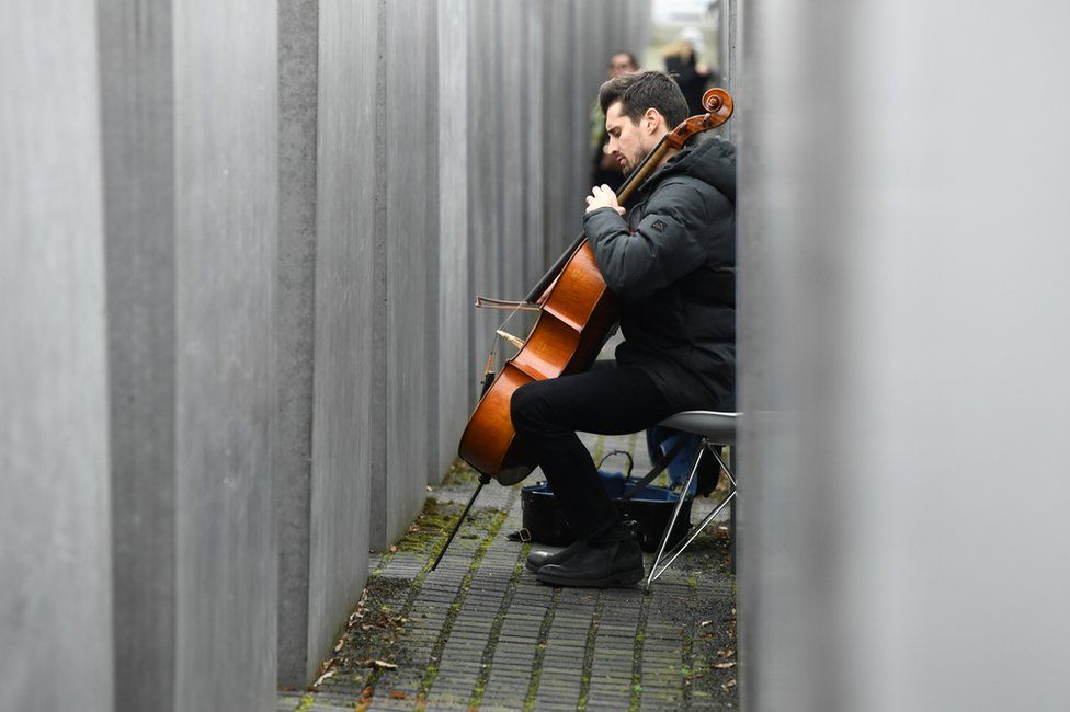 Slovenian cello Luka Sulic plays as part of a service
