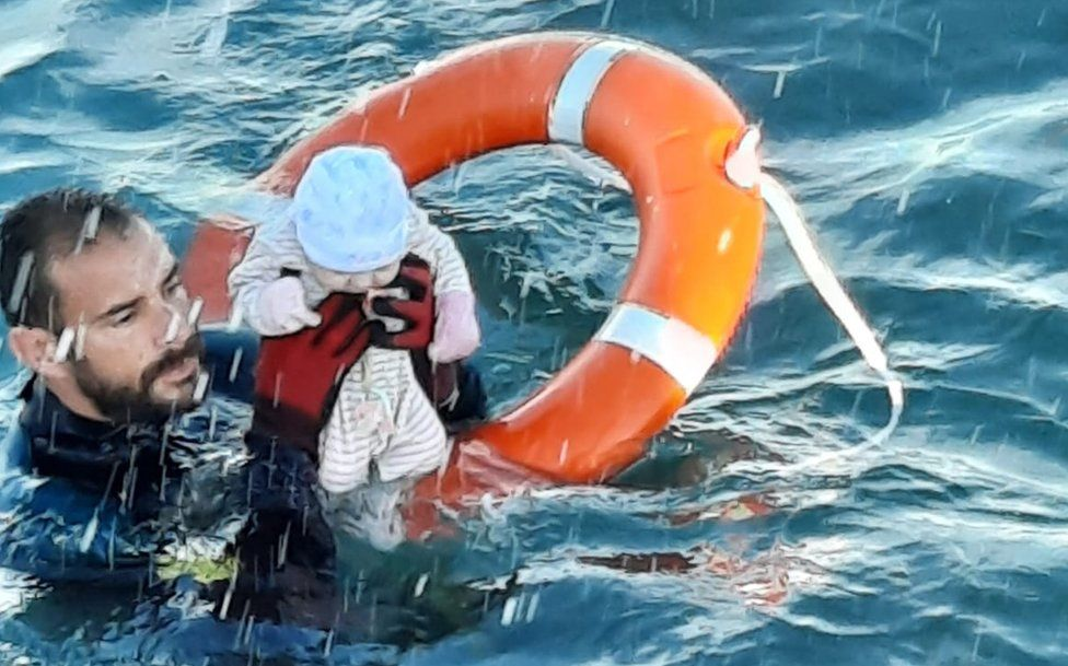 Spain's Guardia Civil posted pictures of a baby and toddlers being rescued from the sea off Ceuta