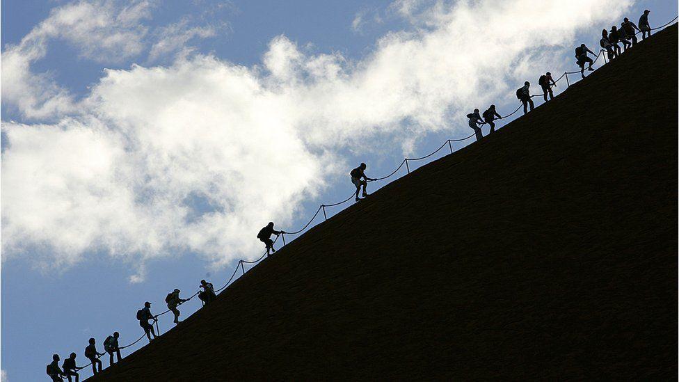 Tourists climbing Uluru in 2005