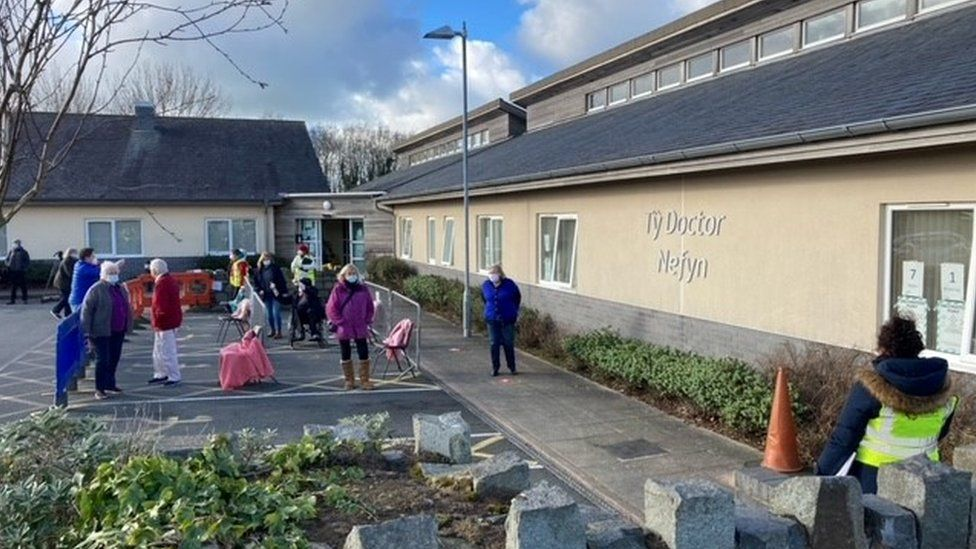 Patients queue outside the Ty Doctor surgery in Nefyn