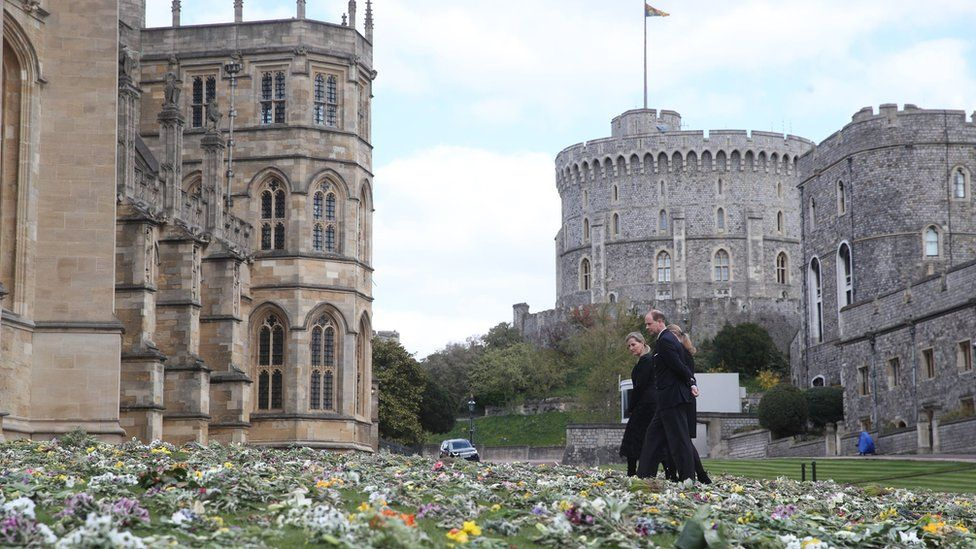 The Countess of Wessex, Lady Louise Windsor and the Earl of Wessex view flowers outside St George's Chapel, at Windsor Castle, on 16 April 2021