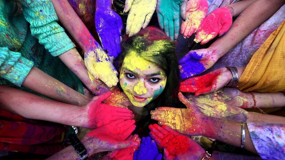College students pose for a photo as they take part in the Holi festival