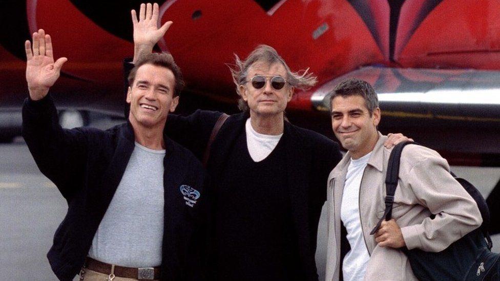 Schumacher, centre, with Arnold Schwarzenegger and George Clooney