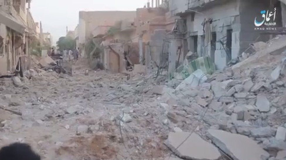 Screengrab of video released by IS news agency Amaq purportedly showing aftermath of air strike on Al-Bukamal, on Syria's border with Iraq