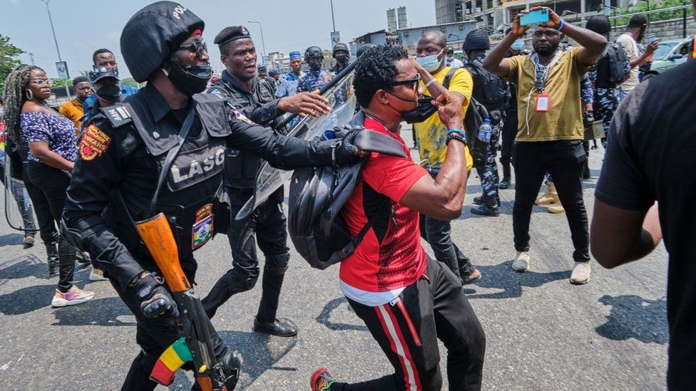 A policeman arresting a protestor during a demonstration against the re-opening of the Lekki toll plaza in Lagos. Activists had called for a renewed protest following a judicial panel authorization of the reopening the city's toll gate, the flash point of the #EndSARS protests against police brutality, where the military shot at peaceful protesters on 20th October 2020