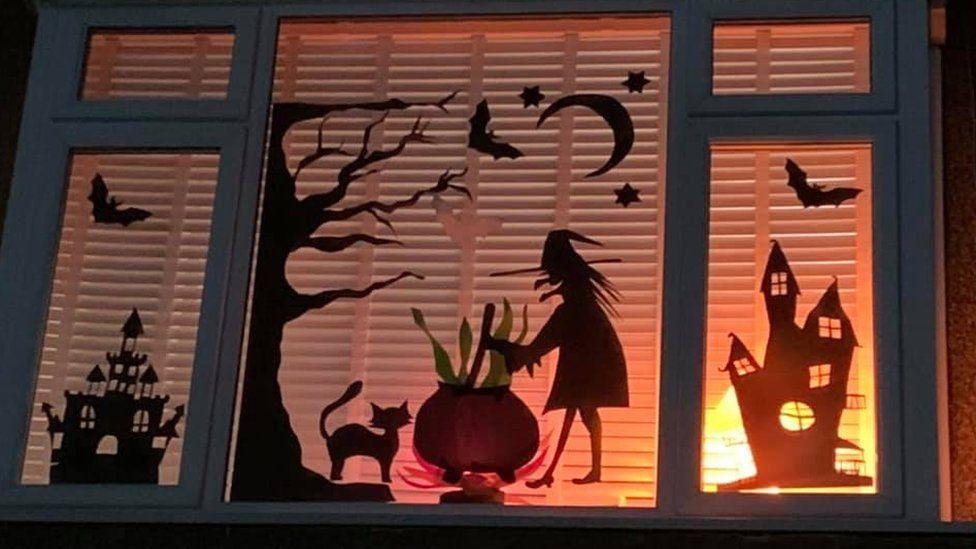 Witch and cauldron window display