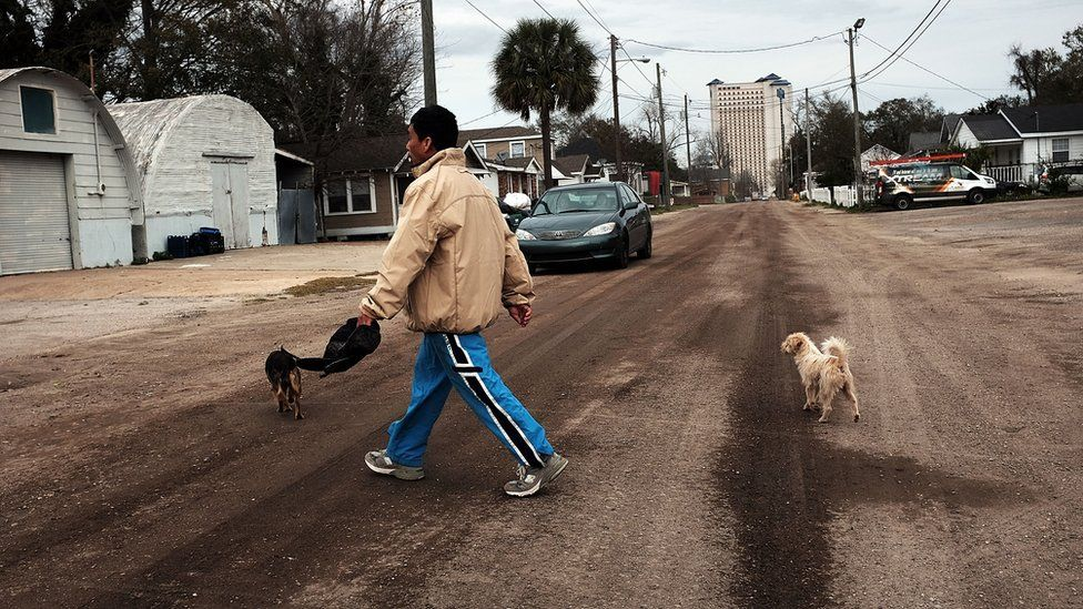 Man crossing street in Biloxi, Mississippi
