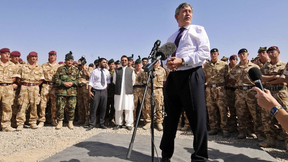 British Prime Minister Gordon Brown addresses British soldiers of the Nato-led International Security Assistance Force (ISAF) at Camp Bastion in Helmand Province, 21 August 2008