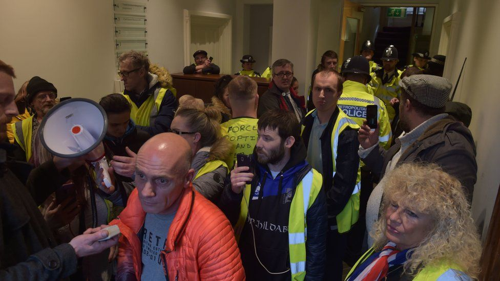 Protesters inside the attorney general's office building