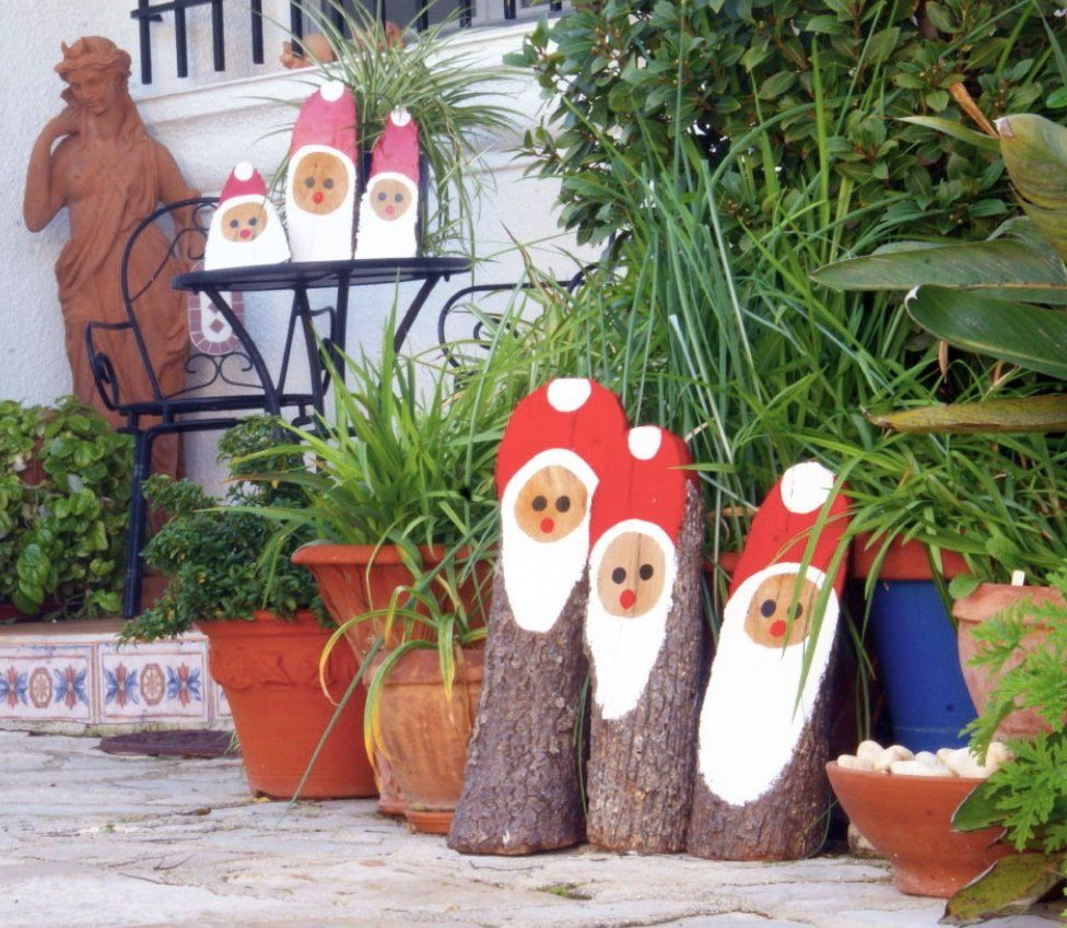 Logs painted as Father Christmas in Costa Blanca