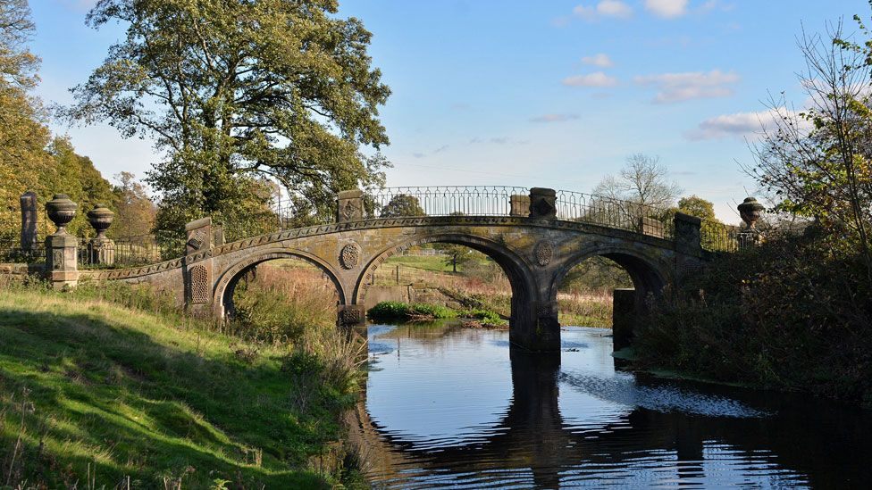 A bridge over the River Dearne at the Yorkshire Sculpture Park near Wakefield