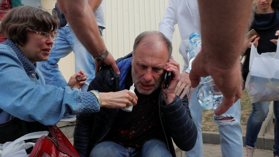 A man reacts outside a detention centre as paramedics arrive to deliver medical support to his son, who was detained during recent protests against the presidential election results in Minsk, Belarus August 13, 2020