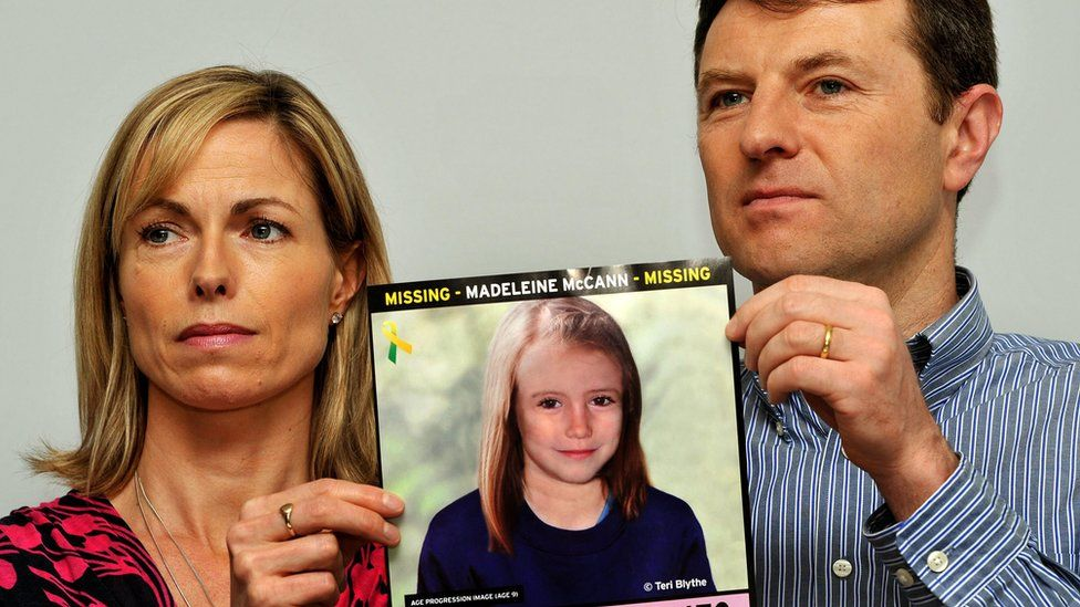 Kate and Gerry McCann pose with a computer generated image of how their missing daughter Madeleine might look now, during a news conference on May 2nd 2012